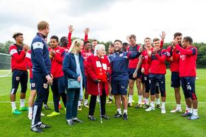 the heartwarming moment 100-year-old bristol city fan is celebrated by lee johnson and players
