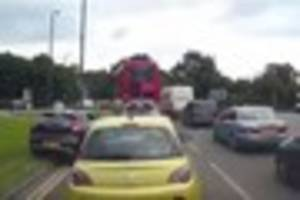 This impatient driver's dodgy manoeuvre in busy traffic will...