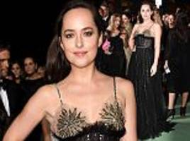 Dakota Johnson goes braless for ecofriendly fashion awards