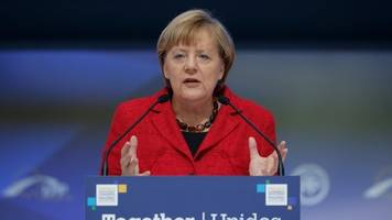angela merkel projected to remain german chancellor