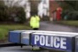 woman left unhurt after car 'hit the central reservation' and...