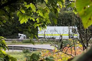 m3 closure: police reveal 'flammable material' thrown on road caused hours of traffic chaos while bomb squad investigated but incident not seen as terrorism related