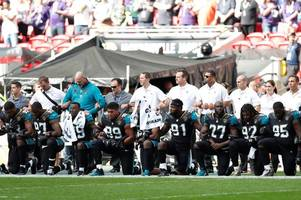 NFL protest comes to Wembley as players kneel during national anthem in defiance of Donald Trump