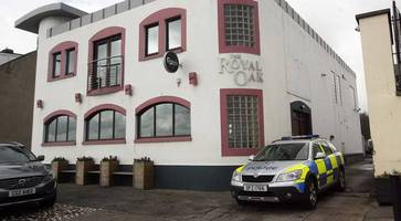 attempted murder charge dropped for trio accused of 'beating bouncer with fire extinguisher' in carrickfergus loyalist feud