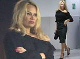 Pamela Anderson supports her footballer beau Adil Rami