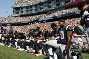 'sunday night football' ratings slip double digits on day of large-scale nfl player protests