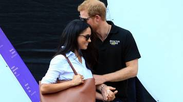 Harry and Meghan Markle seen hand-in-hand