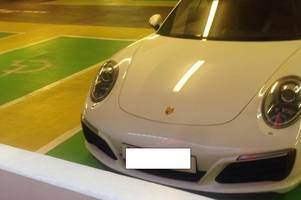 Untaxed Porsche worth £100,000 pictured parked in disabled bay of Cabot Circus car park