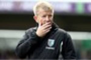 former bournemouth defender relieved of his duties at gillingham