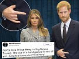 conspiracy theorists say prince harry used demon hand sign
