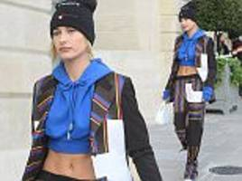 hailey baldwin flashes her taut abs in cropped sweatshirt