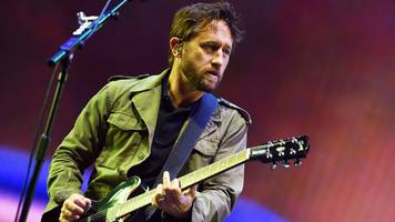 lawro takes on foo fighters guitarist shiflett