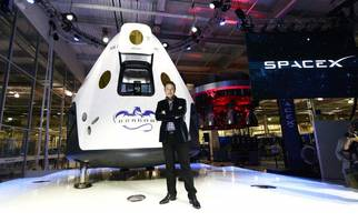 elon musk reckons he can help humans reach mars and the moon by 2024