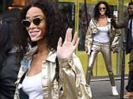 winnie harlow goes for gold at l'oreal show during pfw