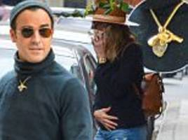 justin theroux still wearing gun necklace, with aniston