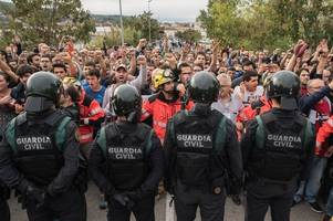 catalonia declares a landslide win for the 'yes' side in ugly scenes of mayhem after riot police attack voters