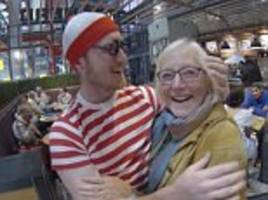 son surprises mum at heathrow with where's wally? game