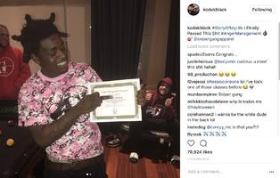 "kodak black grabs his w & waves it high: ""finally passed this s**t"""