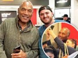 oj simpson gets iphone in first public outing since