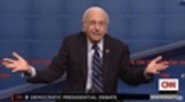 watch as a delighted larry david & bernie sanders find out they're cousins