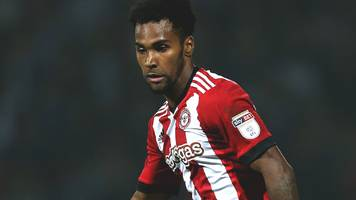 rico henry: brentford defender suffers 'significant' knee injury