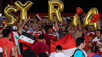 iranian football referee under fire as syrians celebrate