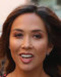 myleene klass raises temperatures as bra-baring dress blows in the wind