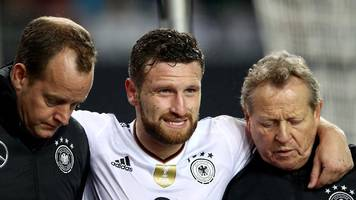 arsenal's mustafi injured as germany complete 100% record