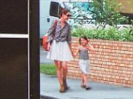 katie holmes and suri cruise superimposed in flats advert