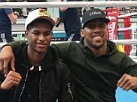 marcus rashford checks in to see anthony joshua