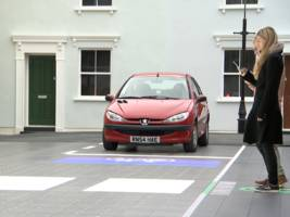 a 'smart crossing' prototype with led lights under the road has been unveiled in london