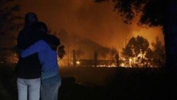 At least 10 dead as fires rage in California wine country