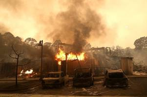 Ten dead as wildfires sweep through California forcing 20,000 people to flee their homes