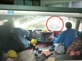 lorry is rattled by a car that drives under it in china