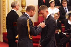 swimming ace adam peaty receives mbe from hrh prince william at buckingham palace ceremony