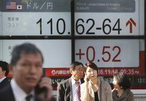 Asian shares hit decade highs after Wall Street ekes out fresh records
