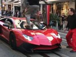 lamborghini owner shocked as man jumps onto his car