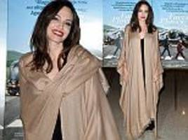 Angelina Jolie looks carefree at Faces Places premiere