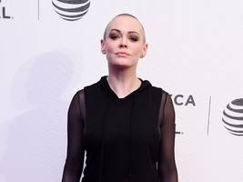 Rose McGowan says she told the head of Amazon's studio that 'HW' raped her, and that she 'was ignored'