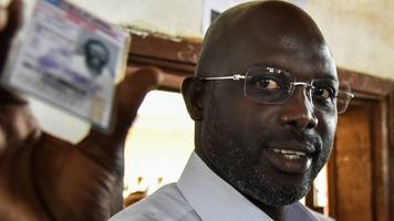 liberia election: ex-football star george weah takes early lead