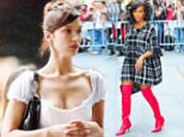 rock a mini dress with knee high boots like bella hadid