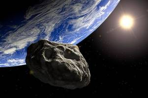 asteroid 'as big as a house' narrowly misses satellites in earth flyby