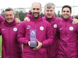 Pep Guardiola poses with Manchester City coaches