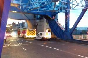 man rescued from river hull with woman has been arrested