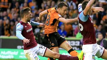 wolves beat rivals aston villa to go top of championship