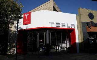 tesla fires hundreds of employees after performance review