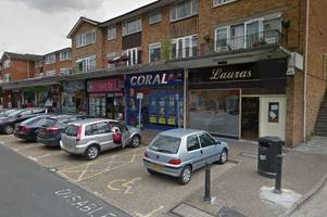 sunbury armed robbery: suspect clad in black balaclava threatens staff with weapon and makes off with cash from bookmakers