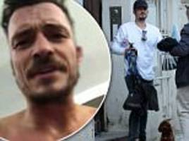 orlando bloom walks his pooch mighty in prague
