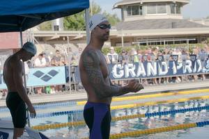 olympic swimming champion ervin kneels during us anthem