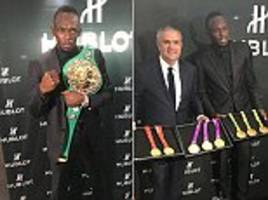 Usain Bolt shows off his medals in Mexico